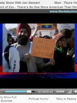Sikh holds a sign at the Rally to Restore Sanity