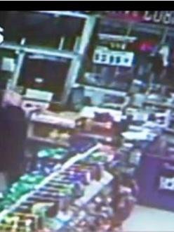 """Security footage of a Sikh thwarting a robber attempt by the """"KISS Bandit"""" (photo capture: news10.net)"""