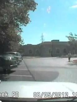 Still from Lt. Brian Murphy's Dash Cam video showing the mass murderer during his attack on the Gurdwara in Oak Creek, Wisconsin