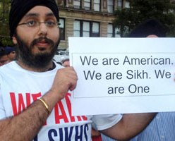 """A Sikh youth holds a placard at an event in Manhattan to mourn the killing of six Sikh worshippers at a Wisconsin gurdwara. (PTI)"""