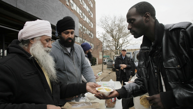 """Sikh Community Center volunteers serving hot meals in the Far Rockaways, via AP."" (source: Gawker)"