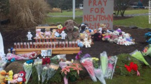 """Ken Henggeler started this memorial to the victims of the shooting at the intersection of Main Street and Sugar Street in Newtown, Connecticut."" (source: CNN)"