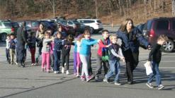 Children are evacuated from their elementary school in Newtown, CT, after a shooter attacked on December 14, 2012. (source: CNN)