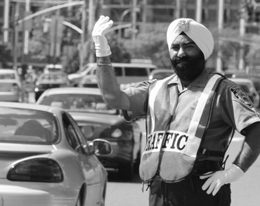 Jasjit Singh Jaggi serves as a member of the NYPD with his articles of faith intact, after winning his religious accommodation case in 2004. As a result of the decision, the NYPD allowed him to serve only as a traffic officer. (source: New York City Commission on Human Rights)