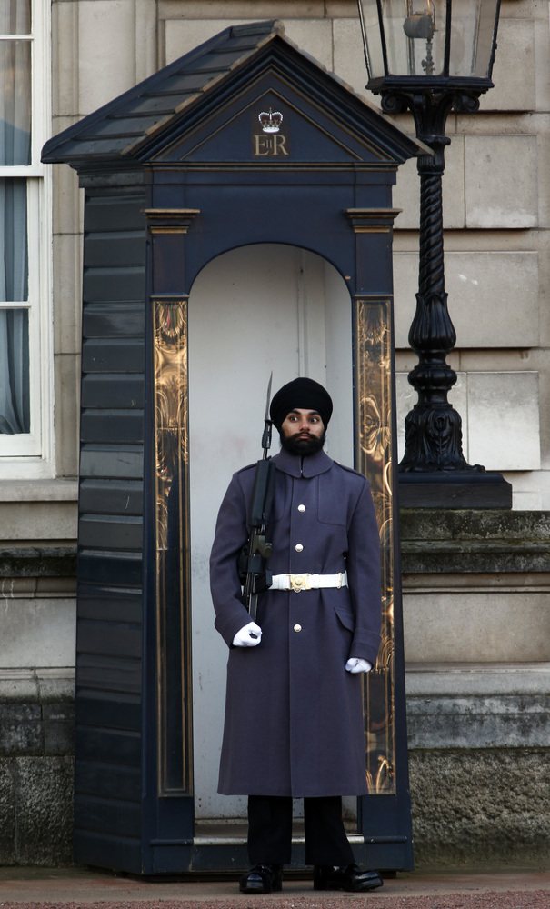 Jatinderpal Singh Bhullar, 25, a Sikh soldier with the Scots Guards, performs guarding duties outside Buckingham Palace in central London, Tuesday, Dec. 11, 2012. becoming the first guardsman to parade wearing a turban instead of the famous bearskin. (source: Huffington Post)
