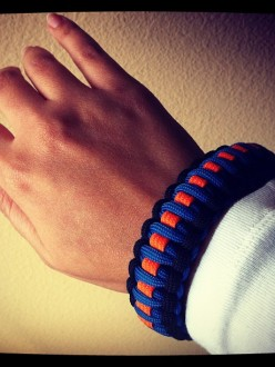 Woven bracelet that the Oak Creek Police Department had specially made for their officers to remember the shooting at the Oak Creek Gurdwara, including orange for the Sikh community, blue for the police officers, and black for those that were lost that day. (source: Sikh Coalition)