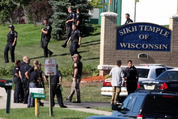 Police action during the shooting attack on the Sikh Temple of Wisconsin in August 2012. (source: Daily Record and Sunday Mail)