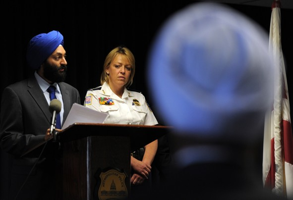 """""""EWEL SAMAD/AFP/GETTY IMAGES - Metropolitan Police Chief Cathy Lanier listens as Jasjit Singh, Executive Director, Sikh American Legal Defense and Education Fund, speaks during an event to release the department's new uniform and appearance rules May 16 at MPD headquarters in Washington."""" (source: Washington Post)"""