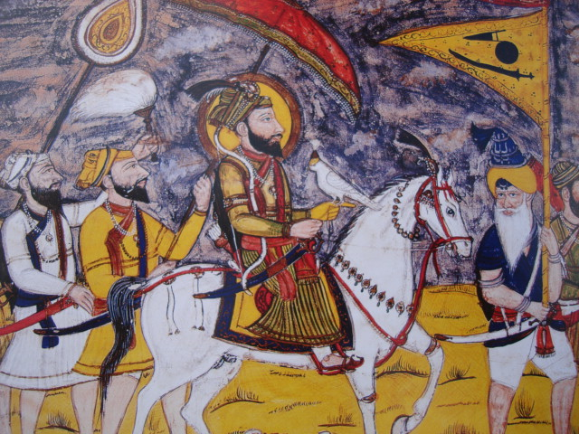 Rajastani style painting of Guru Gobind Singh (seated on horse) entitled 'Journey to Deccan', circa AD 1770-80 (source: SikhSangat.com)