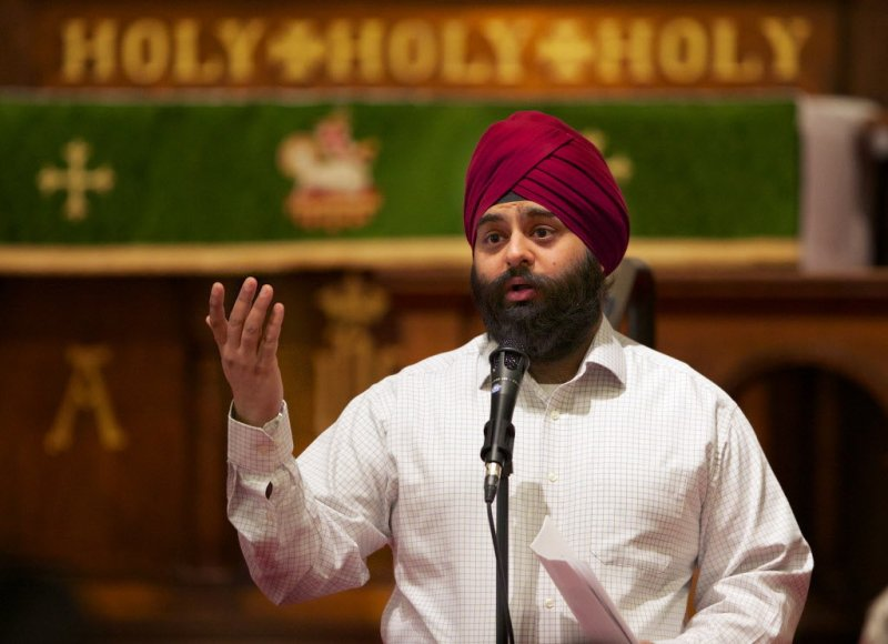 """""""Pawneet Sethi, a Portland Sikh, talks about wrapping his uncut hair in a turban. Many Sikhs refuse to cut their hair as a sign of respect for God'€™s creation. Sethi spoke at '€œLet the Light Shine', an annual lecture series at St. James Lutheran Church in downtown Portland."""" (Randy L. Rasmussen/The Oregonian)"""