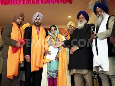 The family of Satwant Singh Kaleka was honored by Sikh officials in Amritsar, India (source: demotix.com)