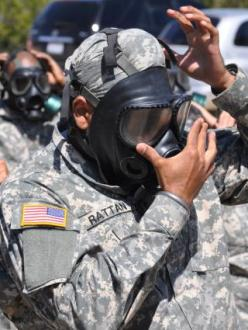 Tejdeep Singh Rattan dons a gas mask during his military training in 2010. (source: US Army)
