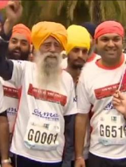 Fauja Singh finishes his last race in Hong Kong on Saturday. (source: CNN)