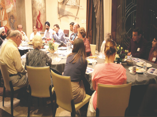 """Discussions over the dinner table at Bobby and Jasmeeta Singh's home."" (source: Indo American News)"
