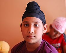 Sikh boy wearing a patka. (source: Wikipedia)