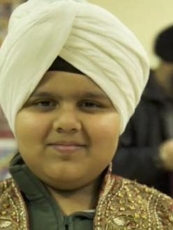 A boy in a turban during the Sikh Turban Showdown at the Sikh Foundation of Virginia in January. (source: PBS)