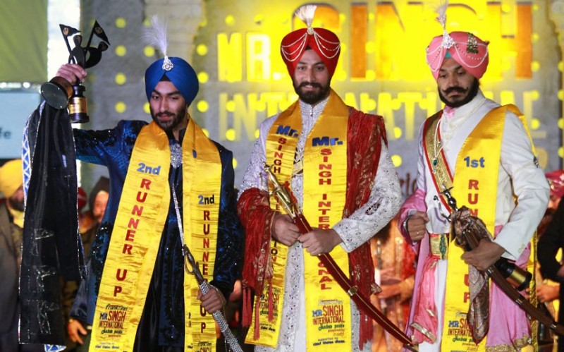 Tejinder Singh, the winner of the title of Mr Singh International 2012, poses with first runner-up Deepinder Singh (right) and second runner-up Tarundeep Singh (Picture: EPA/RAMINDER PAL SINGH/The Telegraph)