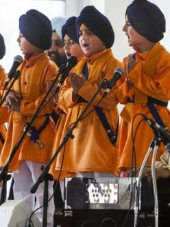 Five young Sikhs representing the first five initiated members of the Khalsa in 1699, sing during Vaisakhi celebrations at the Sikh Temple of Utah yesterday. (source: Deseret News)