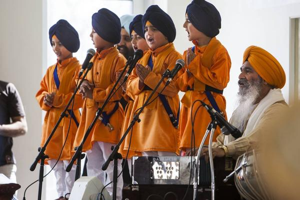 Five young Sikhs, representing the first five initiated members of the Khalsa in 1699, sing during Vaisakhi celebrations at the Sikh Temple of Utah yesterday. (source: Deseret News)
