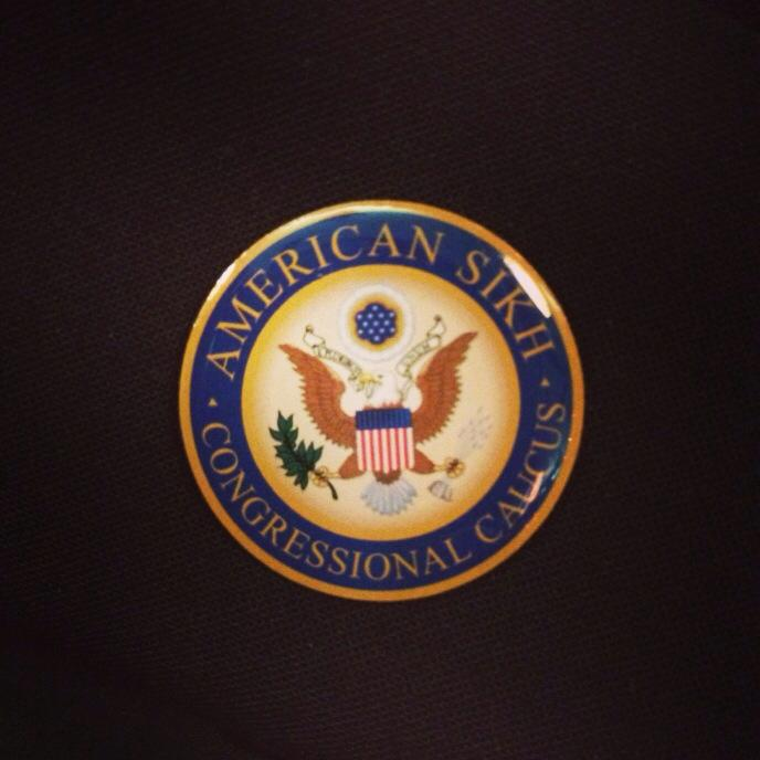 The American Sikh Congressional Caucus pin distributed by Harpreet Singh Sandhu of California. (source: Simran Kaur)