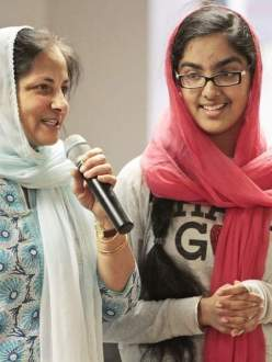 """Dr. Harminder Kaur and her daughter, Hana Mangat, 13, of Potomac, talk with children at the Guru Gobind Singh Foundation Sikh temple about a movie they made to educate people about Sikhism. The first viewing of the film was held Sunday in Rockville."" (credit: Bill Ryan/Maryland Gazette)"