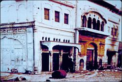 """""""The smoke blackened marble on the right hand side is evidence of the fire which engulfed the Darshani Deori which housed priceless artifacts of Maharaja Ranjit Singh. Bullet marks on the white marble facade are also clearly visible. Blood trails on the left side wall are likely evidence of the executions of captured Sikhs who were shot at point blank range by Indian Army soldiers with their hands tied behind their backs with their turbans as reported by multiple eyewitnesses."""" (source: SikhMuseum.com)"""