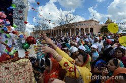 """Sikh devotees throw rose petals into a float bearing Guru Granth Sahib during the annual Hola Mohalla, Sikh Martial Arts Parade and Gatka Exhibition Gallery on Sunday afternoon (03-31-13) in Livingston, CA."" (source: Merced Sun-Star)"