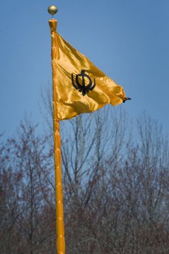 """A flag waves in the wind atop a flagpole wrapped in orange material outside the Sikh Sabha of New Jersey, located in Lawrenceville, New Jersey, in celebration of Vaisakhi"" (source: Michael Mancuso/The Times of Trenton)"