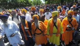 """Participants celebrate the 15th annual Sikh parade as they walk along South San Joaquin Street in Stockton."" (Photo: Michael McCollum/The Record)"