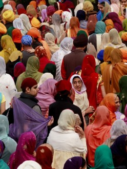 """Thousands walk in Renton's Khalsa Day parade. Sikh men, and some women, wear turbans as one of five external articles of faith called the five Kakars. Women also wear long headscarves called dupattas at religious ceremonies to show respect."" (source: Erika Schultz)"