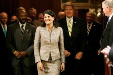 """South Carolina Gov. Nikki Haley enters the State House chamber in Columbia to give her State of the State address in January. Democrat Dick Harpootlian has told activists to ""send Nikki Haley back to wherever the hell she came from."" (Mary Ann Chastain/AP)"" (source: The Daily Beast)"