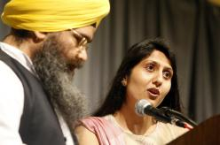 """""""Granthi Amarjeet Singh, left, and Tina Kaur Rekhi of the Sikh faith offer a prayer Thursday morning at the annual Community Prayer Breakfast at Century Center in South Bend sponsored by the United Religious Community."""" (source: South Bend Tribune)"""
