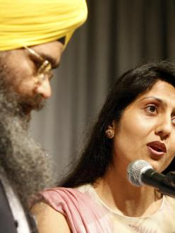 """Granthi Amarjeet Singh, left, and Tina Kaur Rekhi of the Sikh faith offer a prayer Thursday morning at the annual Community Prayer Breakfast at Century Center in South Bend sponsored by the United Religious Community."" (source: South Bend Tribune)"