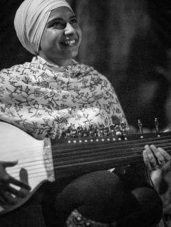 A Sikh woman with a rabab, a traditional Sikh instrument. (Photo credit: Karaminder Ghuman)