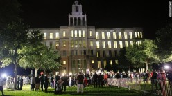 """""""Demonstrators and members of the media gather outside of the courthouse on July 13. The jurors deliberated for more than 16 hours before delivering their verdict."""" (Source: CNN)"""