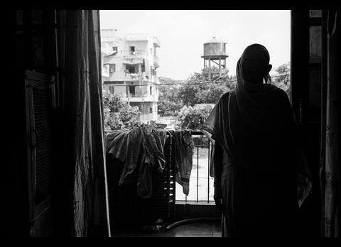 """""""A witness of the 1984 pogrom. More than 10 members of her family were killed before her eyes. She testified in a court that the Congress leader Jagdish Tytler was present at the site of the killings in 1984. Her lawyer was shot at in the very first hearing. She withdrew the case. The aftermath of the violence has left her numb."""" (Credit: Gauri Gill 
