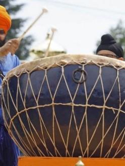 """Jaljit Singh Khalsa, of Beaverton, sets the beat during the procession during annual Sikh celebration honoring Guru Arjan Dev Ji at it leaves the Dasmesh Darbar Sikh Temple, in South Salem, on Sunday, June 16, 2013."" (Photo: Timothy J. Gonzalez | Statesman Journal)"