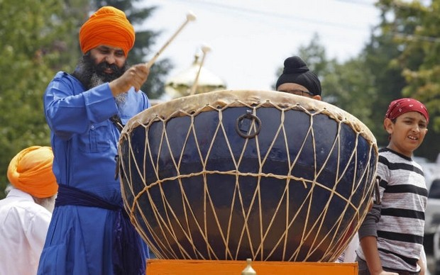 """Jaljit Singh Khalsa, of Beaverton, sets the beat during the procession during annual Sikh celebration honoring Guru Arjan Dev Ji at it leaves the Dasmesh Darbar Sikh Temple, in South Salem [Oregon], on Sunday, June 16, 2013."" (Photo: Timothy J. Gonzalez 