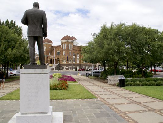 """A statue of Martin Luther King stands across from the historical Sixteenth Street Baptist Church in Birmingham, Ala."" (Photo: Ken Wells, Bloomberg. Source: USA Today.)"