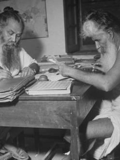 Elderly Sikhs writing. (Source: SikhNet)