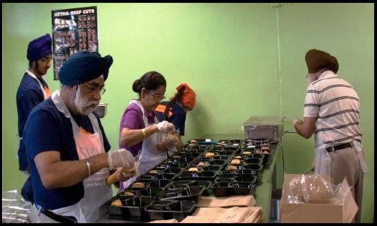 """GP Singh (left, foreground) volunteering with fellow Sikhs at the San Antonio Food Bank."" (Source: San Antonio Express-News)"