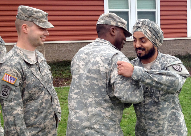 """Cpl. Simranpreet Lamba receives congratulations at his promotion ceremony on Joint Base Lewis-McChord Friday, Sept. 27. 2013."" (Photo: Adam Ashton 