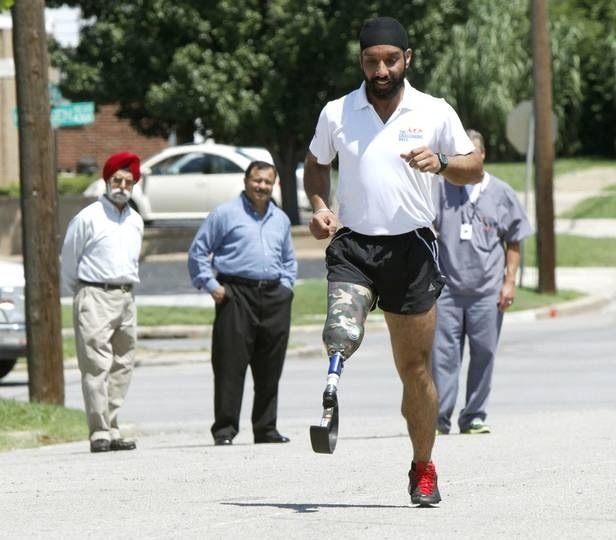 Maj. Devender Pal Singh, an amputee marathon runner from India, tries out a new prosthetic leg outside the Hanger Clinic, 4301 N Classen in Oklahoma City. (Photo Credit: Paul Hellstern | Oklahoman)