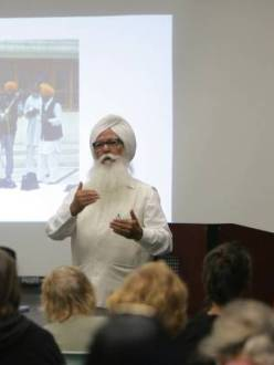 """Santokh Singh Sahi speaks with guest during a meet-greet with members of the Sikh community, on Tuesday, Sept. 10, 2013 at the Glen Avon Library. "" (Credit: STAN LIM/Press-Enterprise)"