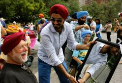 """Sharing a laugh at Turban Day in New York City."" (Source: Huffington Post)"