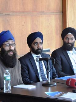 Prabhjot Singh (left) speaks at a press conference with Amardeep Singh (middle) of the Sikh Coalition and Jasjit Singh (right) of SALDEF on September 23, 2013. (Source: The Sikh Coalition)