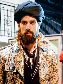 """Urban turban: A model displays a creation for the French designer Jean-Paul Gaultier."" (Source: The Daily Mail)"