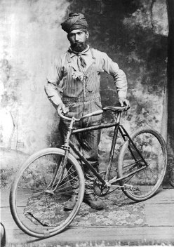 Heara Singh with bicycle, Crawfordsville, Oregon, c. 1900s. (Credit: Stephen Williamson)