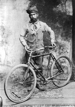 Heara Singh with bicycle, Crawfordsville, Oregon, c. 1900s. (Credit: Stephen Williamson)