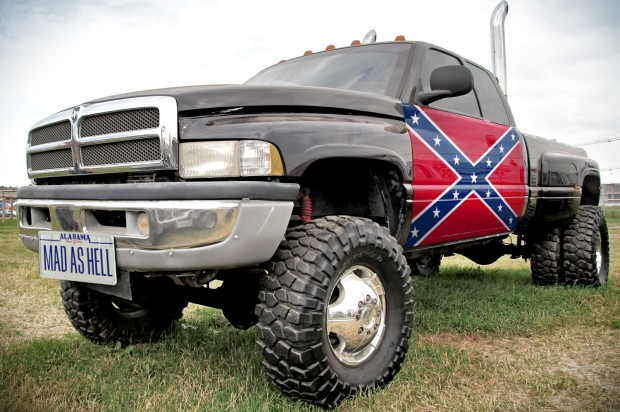 A pick-up truck with the Confederate flag, long associated with America's legacy of enslavement of Africans. (Source: Salon)